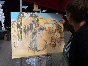 Marcelle Schoenmaker aan het werk als live painter